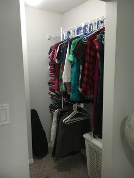 Closet organizer still held off, even after adding clothes.